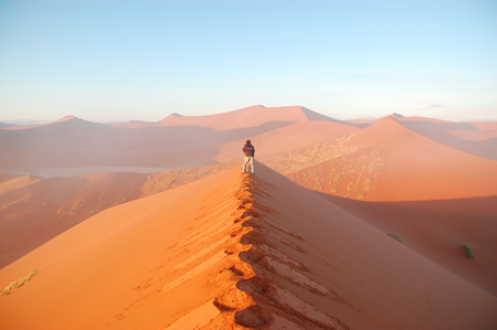 photographer making picture of Namib desert dunes and lanscape, Namibia, Africa Stock Photo