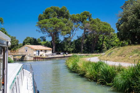 Vacation boat in Canal du Midi, family travel by barge in Southern France Reklamní fotografie