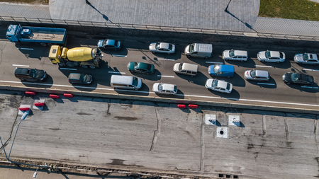 Aerial top view of road automobile traffic jam of many cars from above, block and road repair, city transportation concept