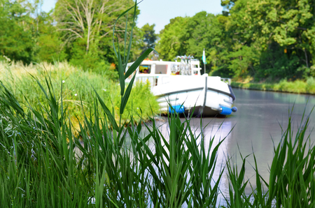 Vacation boat in Canal du Midi, family travel cruise by barge penichette, holidays in Southern France