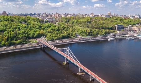 Aerial top view of pedestrian Park bridge, Dnieper river and Kyiv hills from above, city of Kiev, Ukraine Reklamní fotografie