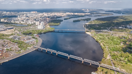 Aerial top view of Dnieper river in Kyiv, Trukhaniv and Rybalskiy islands from above, bridges and cityscape of Kiev city, Ukraine