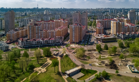 Aerial view of new modern residential Obolon district near Dnieper river in Kiev city, Kyiv cityscape from above, Ukraine