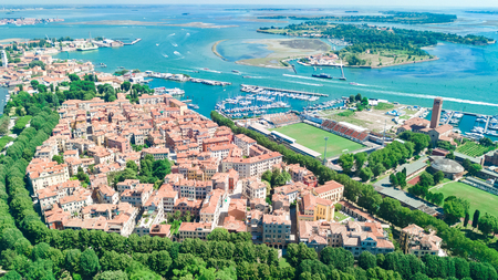 Aerial view of Venetian lagoon and cityscape of Venice island in sea from above, Italy Reklamní fotografie
