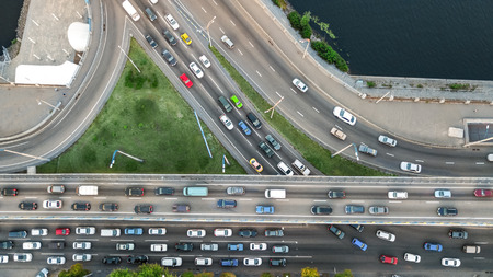 Aerial top view of road junction from above, automobile traffic and jam of many cars, transportation concept