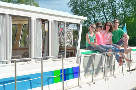 Family vacation, summer holiday travel on barge boat in canal, happy kids and parents having fun on river cruise trip in houseboat in France Reklamní fotografie