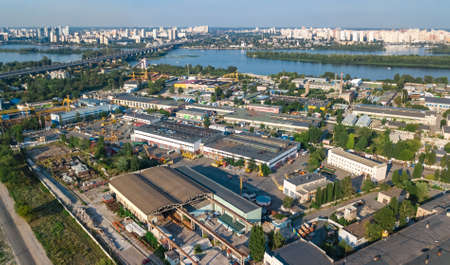 Aerial top view of industrial park zone from above, factory chimneys and warehouses, industry district in Kiev (Kyiv), Ukraine Foto de archivo