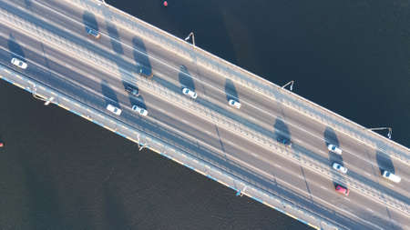 Aerial top view of bridge road automobile traffic of many cars from above, city transportation concept Standard-Bild