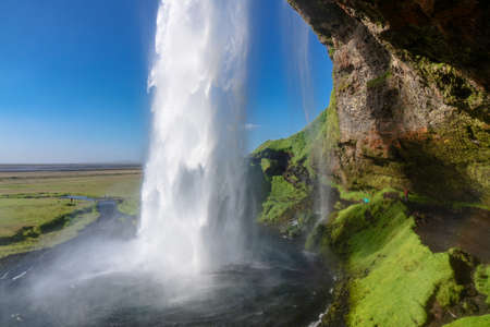 Beautiful Seljalandsfoss waterfall in Iceland, icelandic summer nature and river landscape Standard-Bild