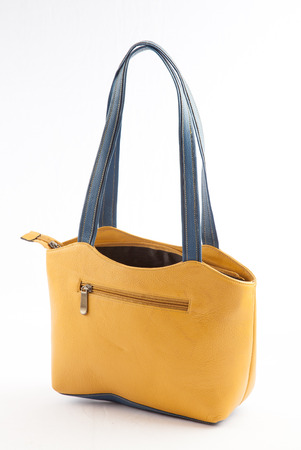 carryall: Yellow ladies hand bag on white background