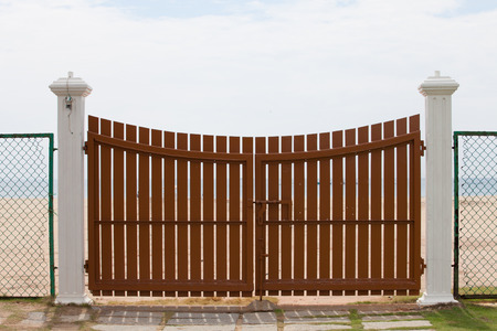 wooden gate closed position with sea background photo
