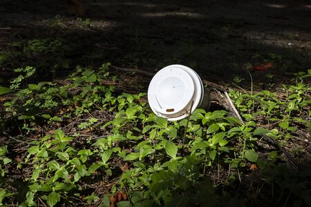 White plastic cup on the ground