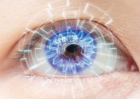 Close-up of womans blue eye. High Technologies in the futuristic. : contact lens Stock Photo