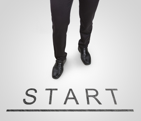 court shoes: Businessman standing wearing court shoes on start(begin) line. Stock Photo