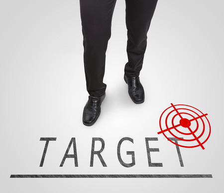 court shoes: Businessman standing wearing court shoes on target(aim) line.