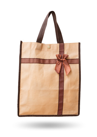 gift bag: Gift bag brown reuse recycle to get in ribbon (bow) isolated on white background. Stock Photo