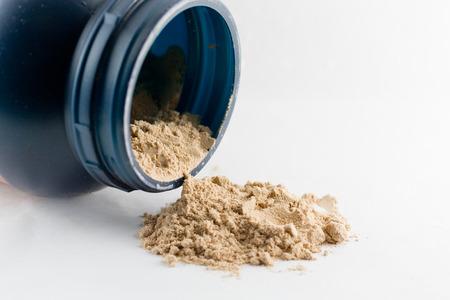 whey: Whey protein chocolate powder isolated on white background.