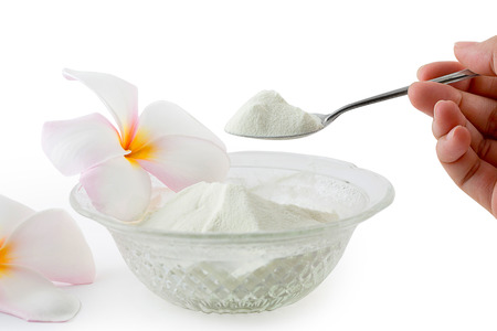 Collagen powder protein on spoon measure isolated on white background. Standard-Bild