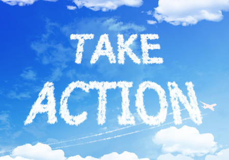 Take action text on the sky. Banco de Imagens