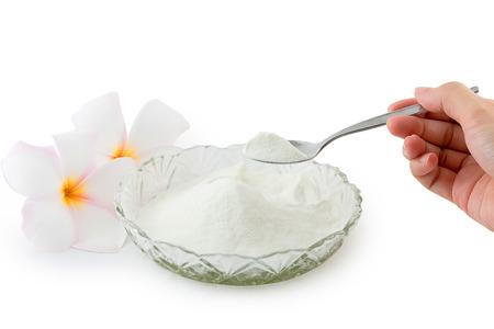 Collagen powder protein on spoon measure isolated on white background. Stockfoto
