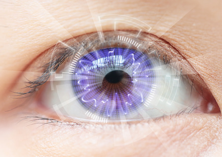 cyber girl: Close-up women eye technology : contact lens Stock Photo
