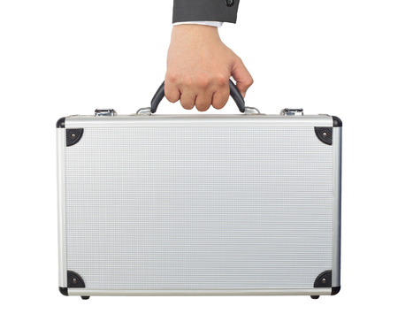 Hand and arm holding silver luggage or brief case isolated on white background.