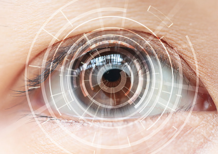 Close-up of woman's brown eye. High Technologies in the future Stockfoto
