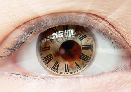 futuristic eye: Female eye roman numerals  bio clock. Stock Photo