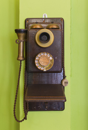 ancient telephone: Antique vintage telephone green background.