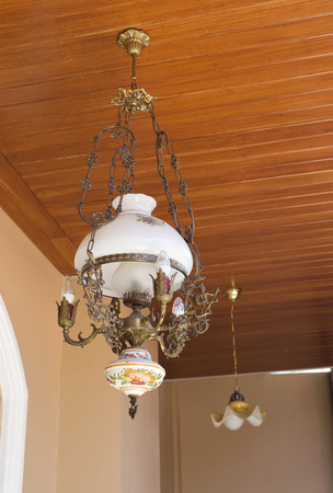 palate: Antique chandelier on wood palate.