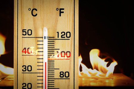 Close-up wooden thermometer scale isolated white background.