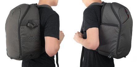 mochila de viaje: Young man standing with travel backpack equipments isolated white background.