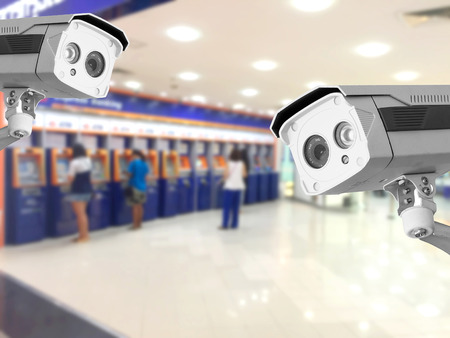 bank records: CCTV Security camera Auto teller machine(ATM)  area background.