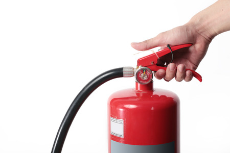 compressed air hose: Close- up Fire extinguisher and catch on red tank.
