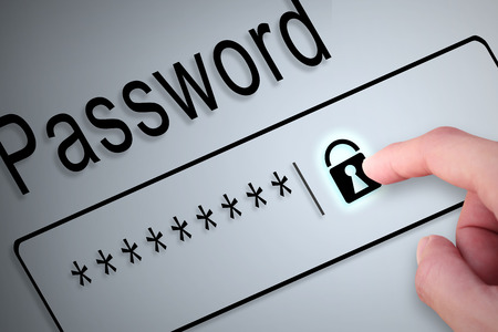 passwords: Close-up hand button lock protect password on screen, beware social online
