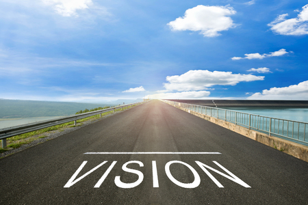 next horizon: VISION - Road surface concrete with text.