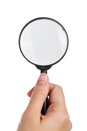 Hand holding magnifier isolated white background. Stock Photo