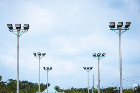 halogen lighting: Close-up spotlight of stadium on the sky. Stock Photo