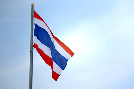 ethnical: The flag of Thailand on the blue sky.