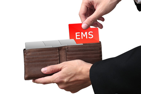ems: Businessman hands paying money for EMS concept on brown wallet.