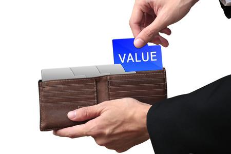 pulling money: Businessman hands pulling money VALUE concept on brown wallet.