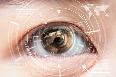focus: Close up woman brown eye scanning technology in the futuristic Stock Photo
