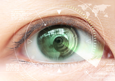 contact person: Close up women eye scanning technology Stock Photo