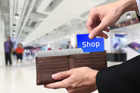 pulling money: Businessman hands pulling money Shopping concept on brown wallet.
