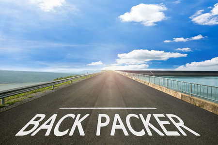 packer: BACK PACKER - Road surface of begin to the trip. Stock Photo