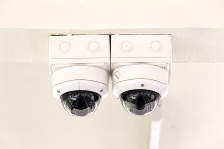 security cameras: Twin CCTV security cameras on ceiling.