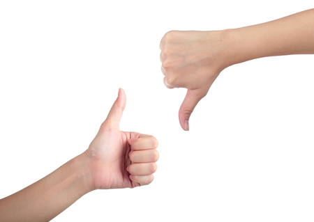 unlike: Young man his hand like with unlike thumbs up isolated white background.