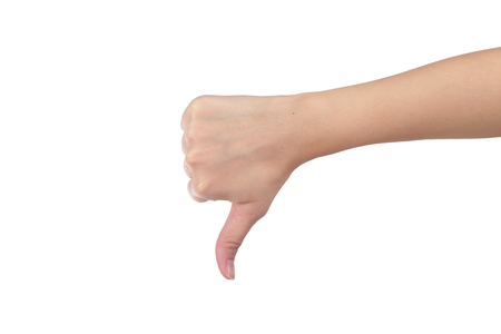 unlike: Young man his hand unlike thumb up isolated white background. Stock Photo