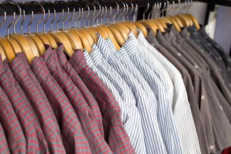 tabulate: Close up shirt hanging in wardrobe.