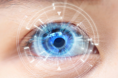 focus on: Close-up of womans blue eye. High Technologies in the futuristic. : contact lens Stock Photo